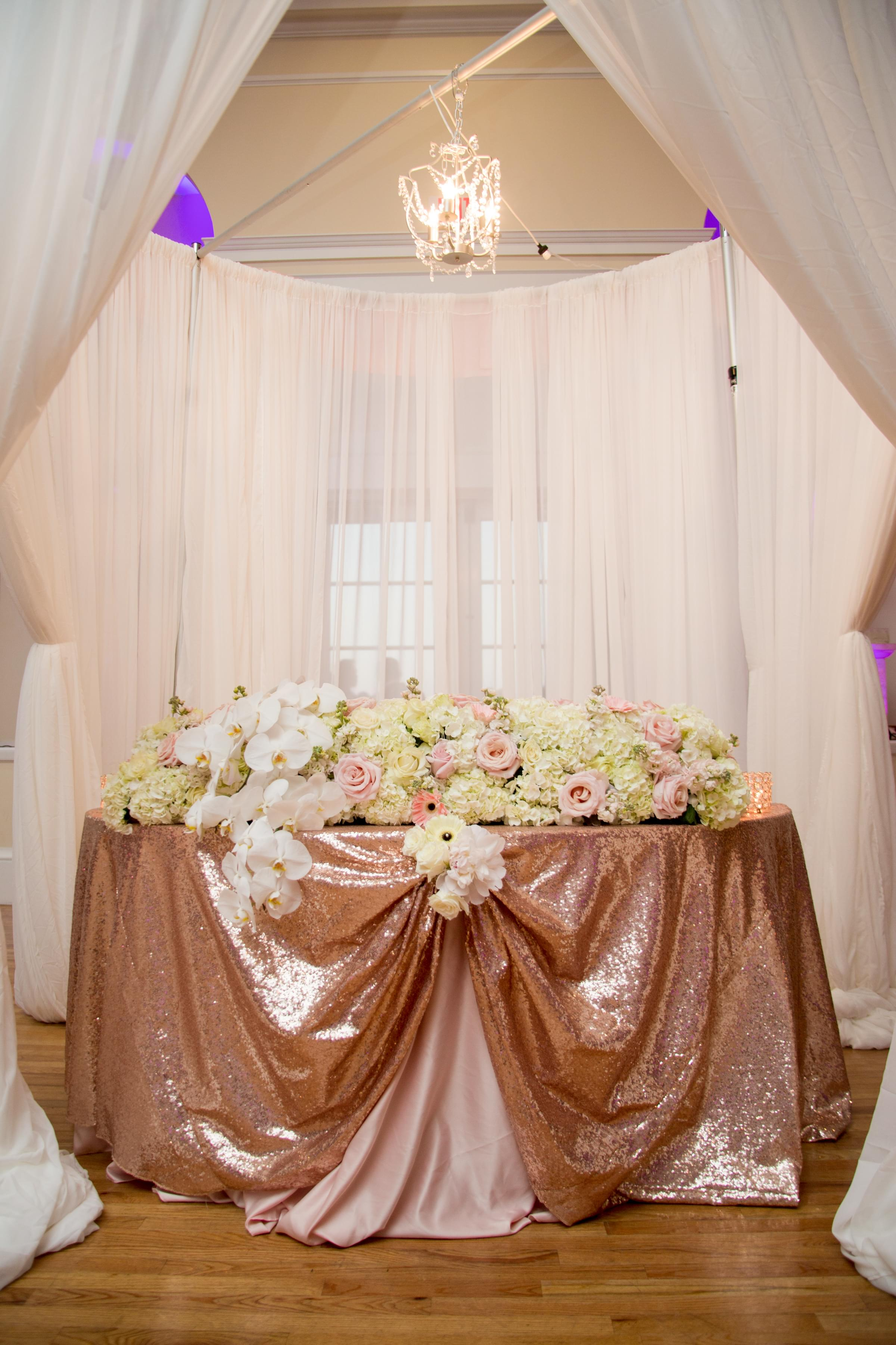 gold and pink rose couples table wedding
