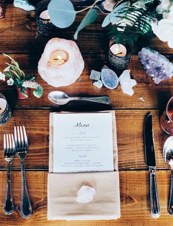 Bright and cheery celestial wedding tablescape with colorful geodes