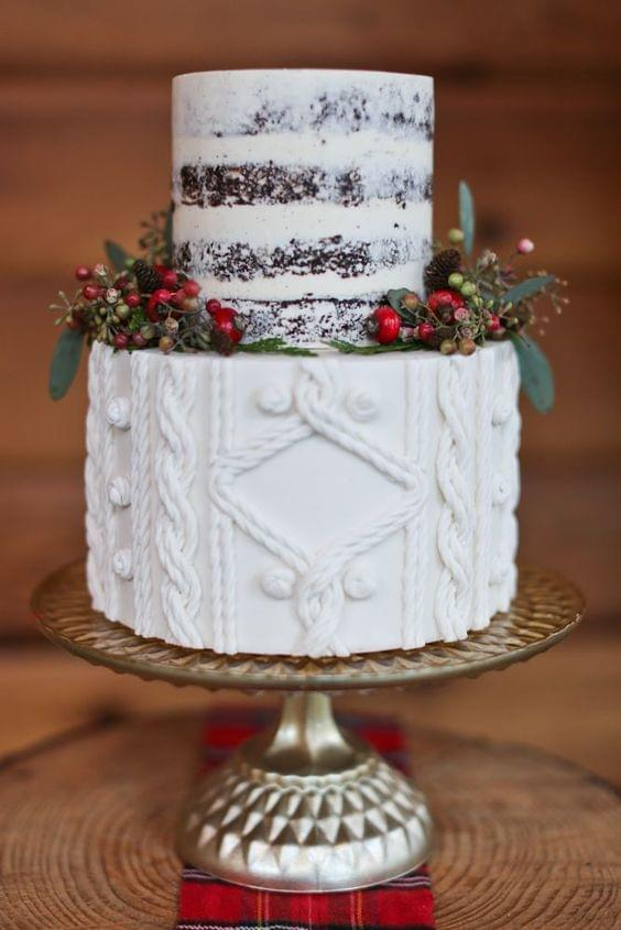 Sweater detail wedding cake with greenery and cranberries
