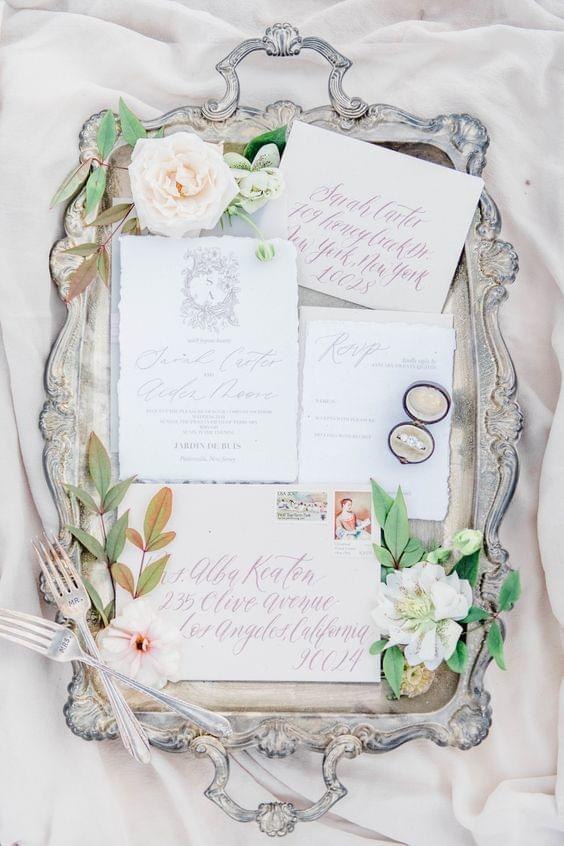 Timeless, elegant invitations with beautiful calligraphy and floral accents