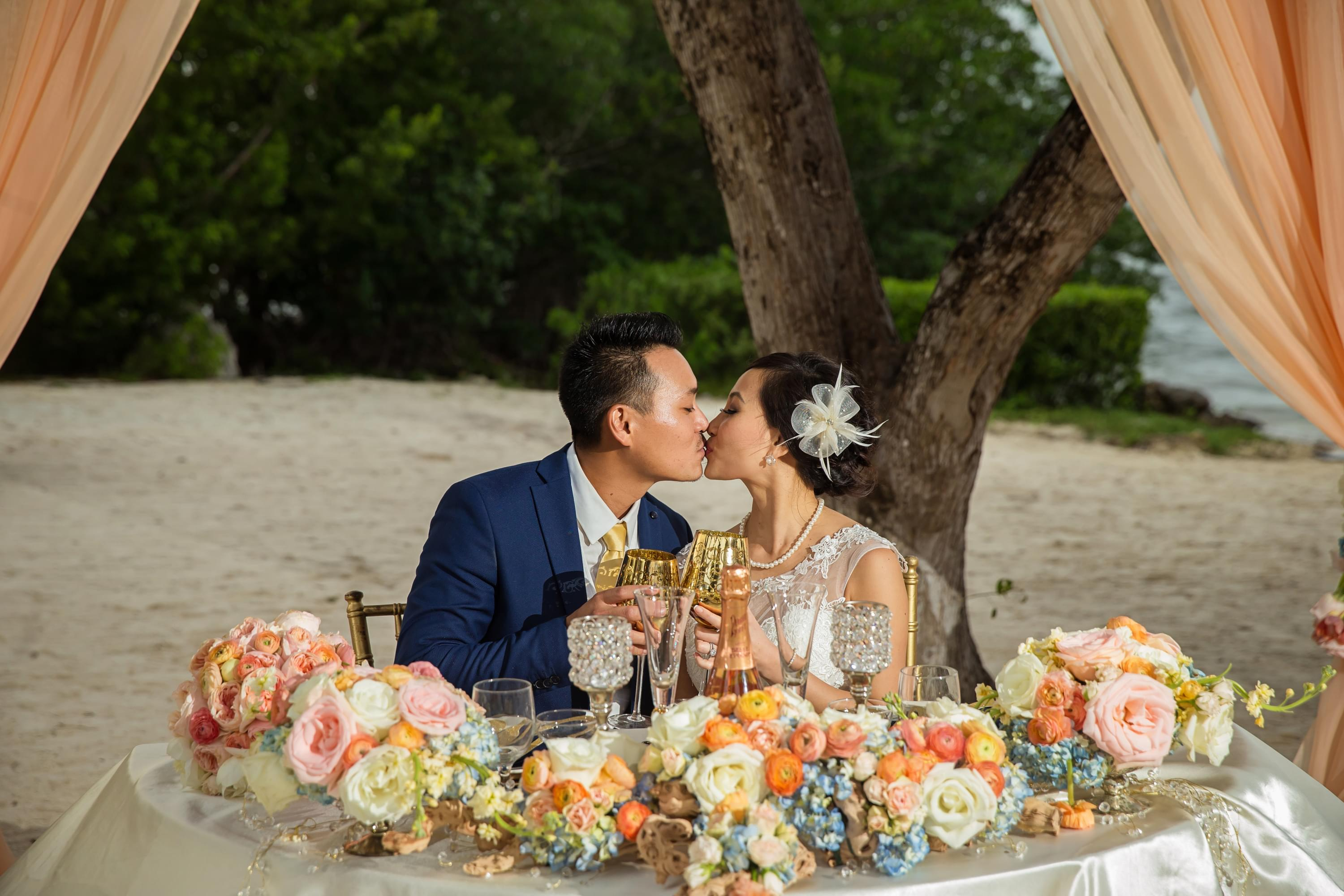 colorful beach wedding couples table