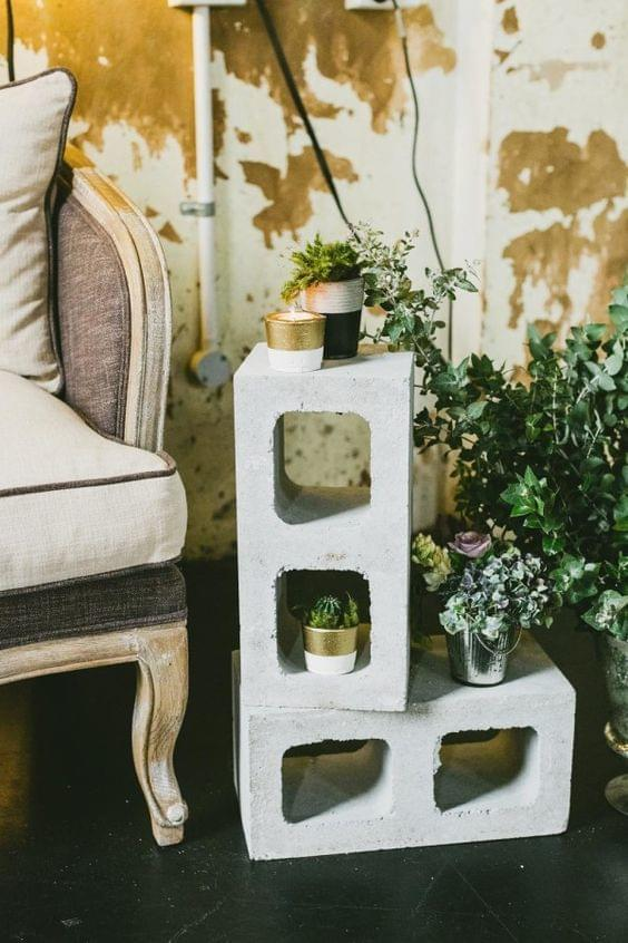 Industrial wedding cinder block decor with potted plants and greenery accents