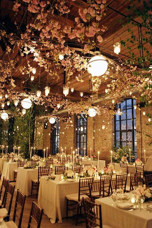 Garden wedding tablescape with hanging flowers and candles