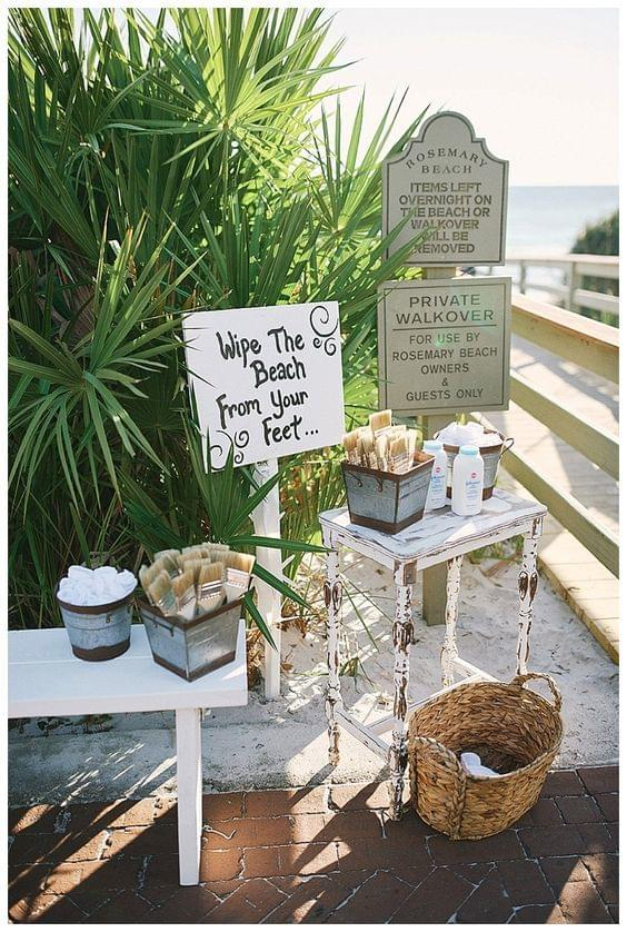 Beach wedding, fun and playful feet-wiping station
