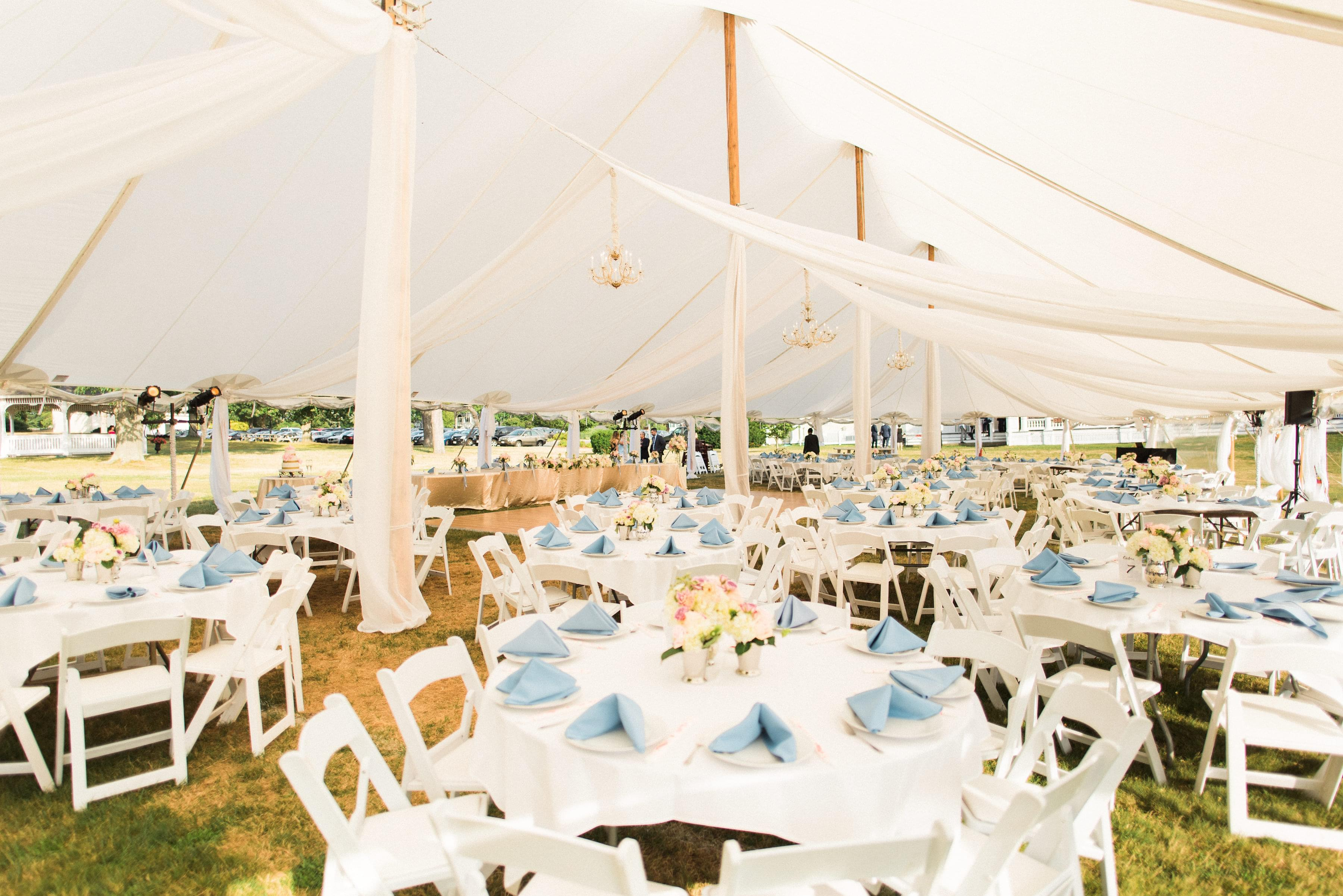 blue and white tent wedding