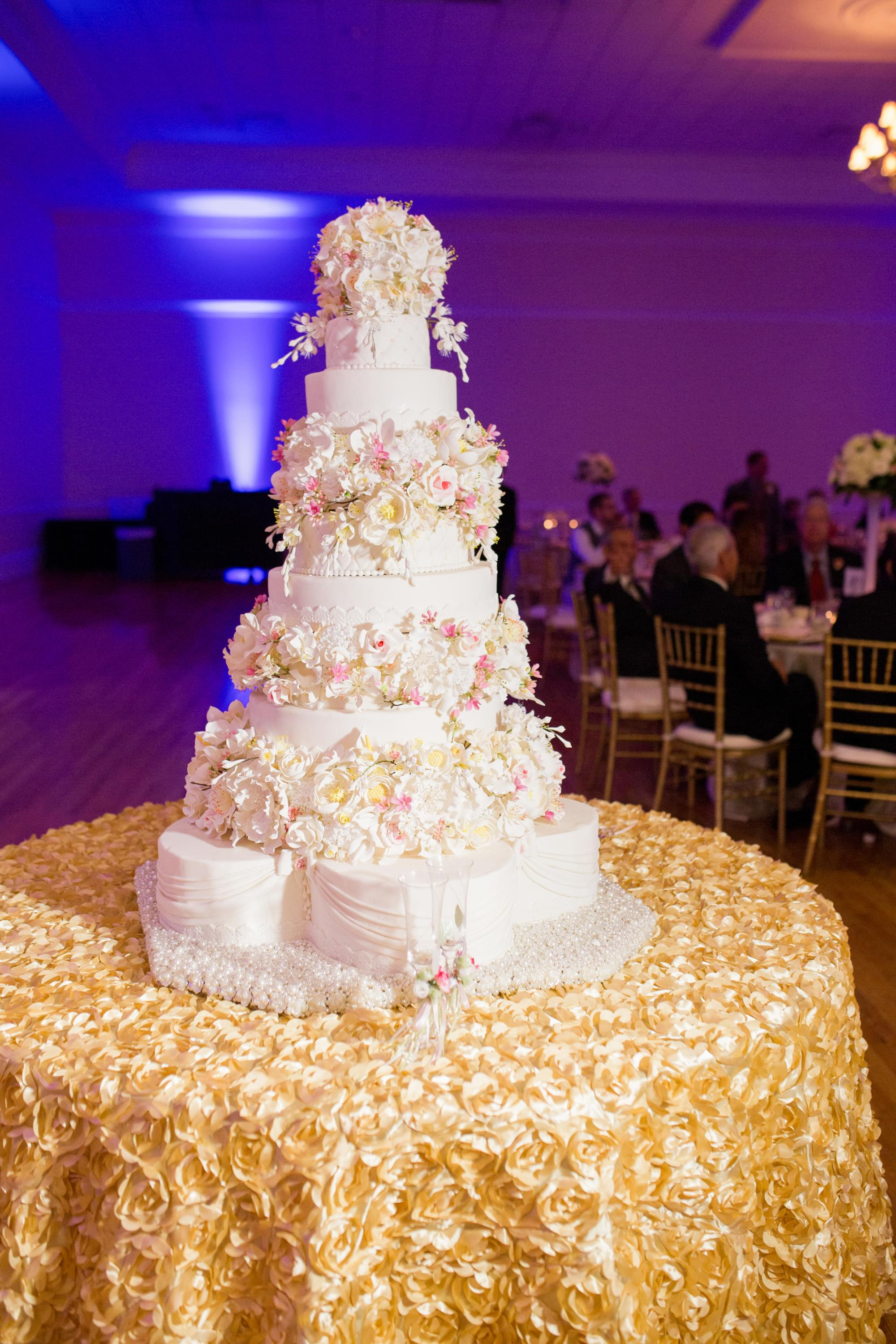 beautiful four layer flower pink wedding cake