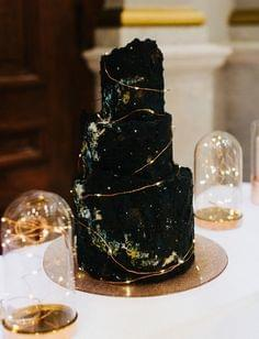Black dark and moody celestial wedding cake with galaxy design and lights