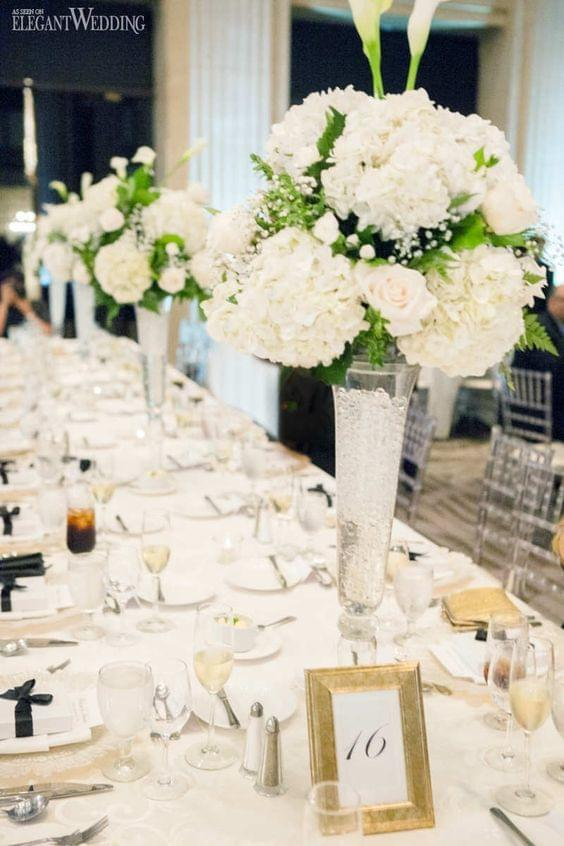 Timeless wedding with white, black, and gold and floral centerpieces